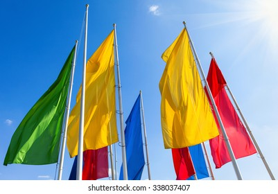 Colorful flags fluttering on the blue sky background