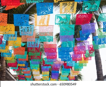 Colorful flags hanging in the town of Sayulita Mexico