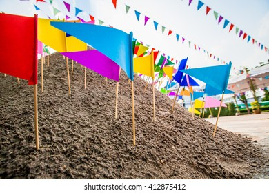 Colorful flags on the sand in Songkran festival at Thailand.
