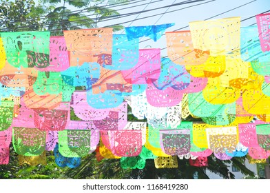 Colorful flags over a mexican street