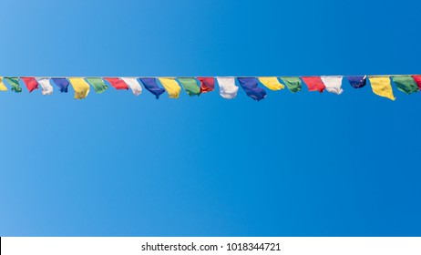 Colorful flags with vivid color use as tailsman for safety travel in tibetan on blue sky background