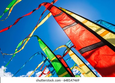 Colorful flags waving in the wind at kite festival in Moscow