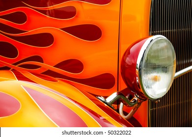 colorful flaming paintwork and headlamp on a custom hotrod