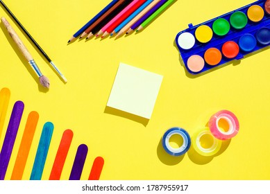 Colorful flat lay background with craft supplies on the way back to school.