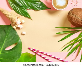 colorful flat lay holiday background with tropical leaves and coconut, top view