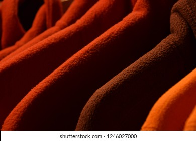 colorful fleece jackets, colorful polar fleece jackets on a hanger macro shot made of recycled plastic bottles