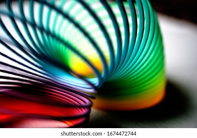 colorful flexible bouncy plastic spring bent into an arch