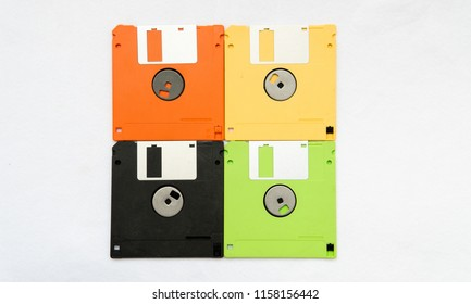Colorful floppy disks on white background.