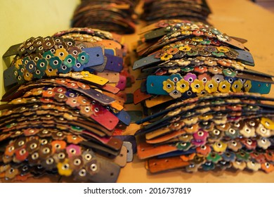 Colorful floral leather bracelets lined up one after the other.