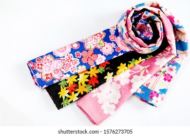 Colorful floral pattern fabric on a white background