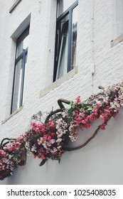 Colorful flower arrangements on the building facade wall