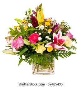 Colorful flower bouquet arrangement centerpiece in vase isolated on white.