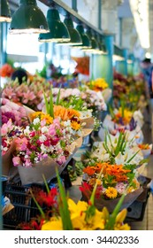 Colorful flower bouquets for sale at the Pike Place Market, Seattle. Short depth of field.