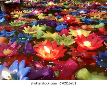 Colorful flower candles light on the water