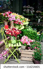 Colorful flower stand on a sidewalk in Paris, France