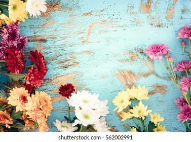 Colorful flowers bouquet on vintage wooden background, border design. vintage color tone - concept flower of spring or summer background.