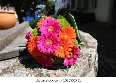 colorful flowers for the bride to the wedding. bouquet with gerbera pink orange green and grass