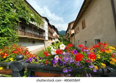 Colorful flowers on a bridge in the small town of Levico Terme, Trentino Alto Adige, Italy, Europe