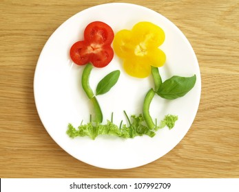 Colorful flowers on a plate made with paprika