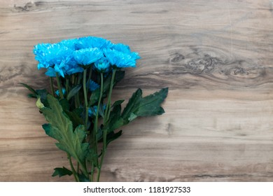 colorful flowers on a wooden table. place for text