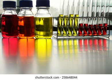 Colorful fluid in bottle and test tube for laboratory use on table laboratory