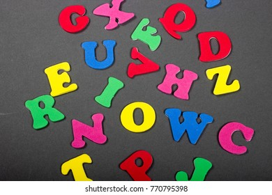 colorful foam letters on gray background