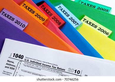 Colorful folders for income taxes of years 2010 - 2005 / TAXES & FOLDERS