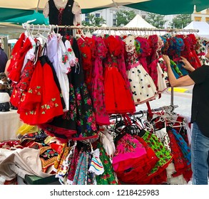 Colorful folk traditional dresses are displayed for sale during the folk art festival in Krakow, Poland.