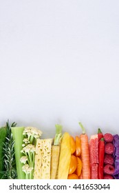 colorful food background, frame border of rainbow spectrum gradient of organic fresh fruit and vegetables