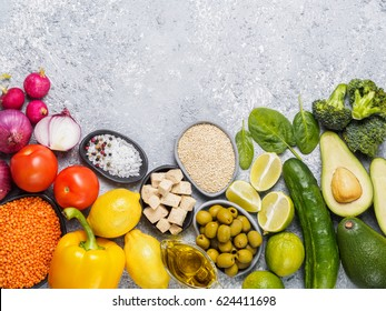 Colorful food background. Vegan food ingredients with copy space. Cereals and vegetables on gray concrete background. Healthy eating concept
