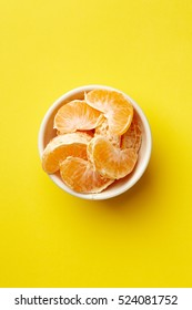 Colorful Food & drink still life concept. Color riot food photography.  Fresh fruits & vegetables on bright color background.  Orange mandarin yellow background.  Closeup. Top view.