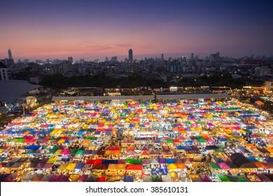 Colorful food stalls at Rod Fai Night Market in Bangkok