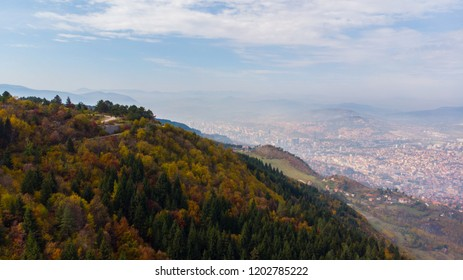 colorful forest and city aerial shoot