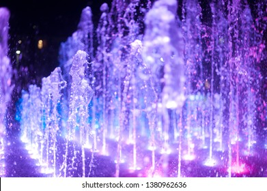 colorful fountain at night (white, pink, blue)