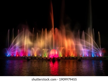 Colorful fountain water at night time in celebration festival .