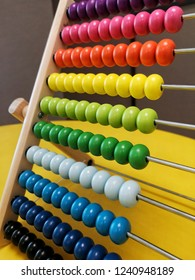 Colorful frame with ball sliding on rods, used for counting or known as abacus