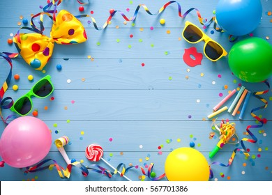 Colorful frame with party items on blue background. Happy birthday concept