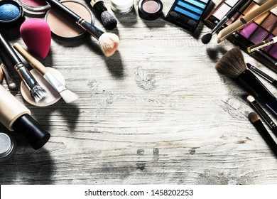 Colorful frame with various makeup products. Beauty background with copy space