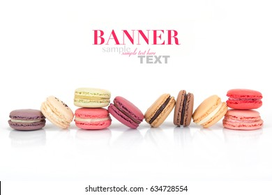 Colorful French Macaron Cookies isolated on white background with sample text. Assorted in a fun layout.
