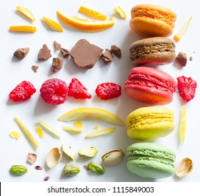 Colorful french macarons abstract still life with fruits and ingredients on white background