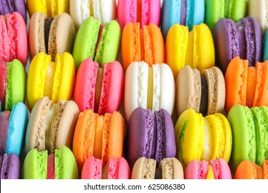 Colorful french macarons background, close up.Different colorful macaroons background.Tasty sweet color macaron,Bakery concept.Selective focus.