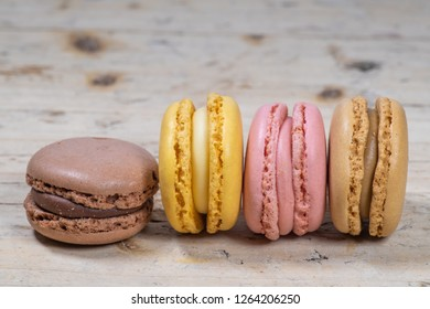 Colorful french macarons isolated on old wood texture background. Pastel colors - Imagen