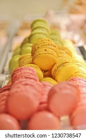 Colorful french macarons or macaroons on display. Meringue based confection, famous in France as sweet dessert or for tea time. Different chocolate or jam fillings between two cookies like a sandwich