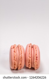 Colorful french macarons with strawberry flavor isolated on white background. Pastel colors - Image