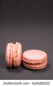 Colorful french macarons with strawberry flavor isolated on black background. Pastel colors - Image