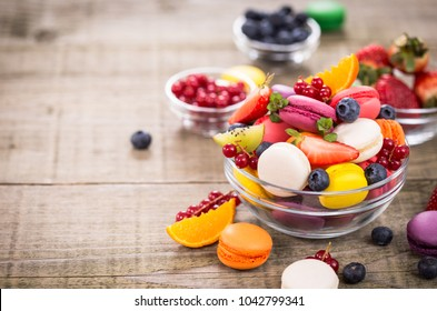 Colorful French macaroons in the bowl