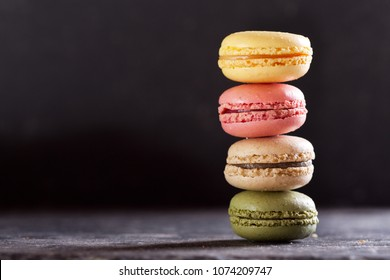 colorful french macaroons on dark table