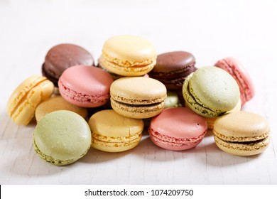 colorful french macaroons on wooden table