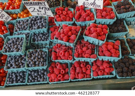 Colorful fresh berries at an outdoor market in Seattle.