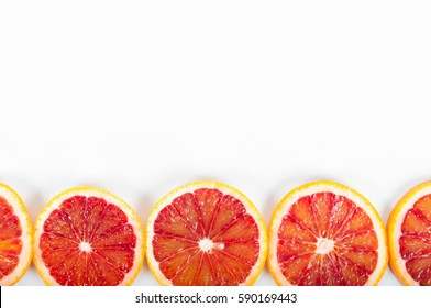 Colorful fresh citrus fruit on white background. Orange, tangerine, lime, blood orange, grapefruit. Fruit background. Summer food concept. Flat lay, top view, copy space